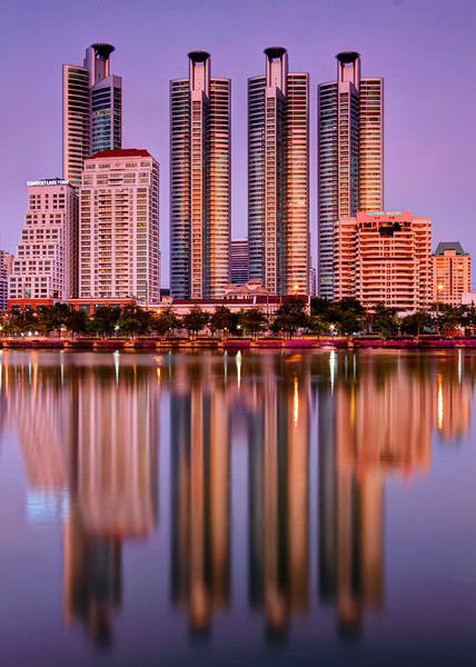 Reflections of 4 Towers on Lake at Dusk