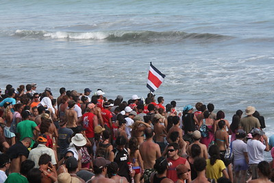 People at the beach with the Costa Rica Flag