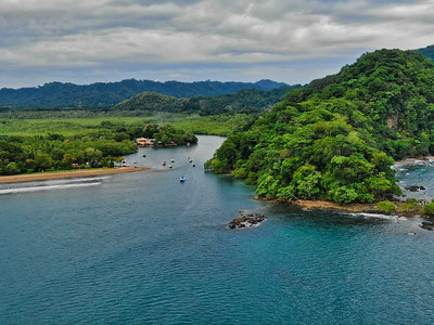 Aerial view of a peninsula in the ocean with blue waters in Costa Rica