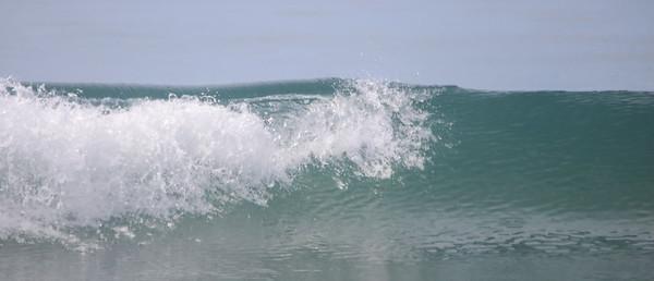 Waves crashing into the ocean