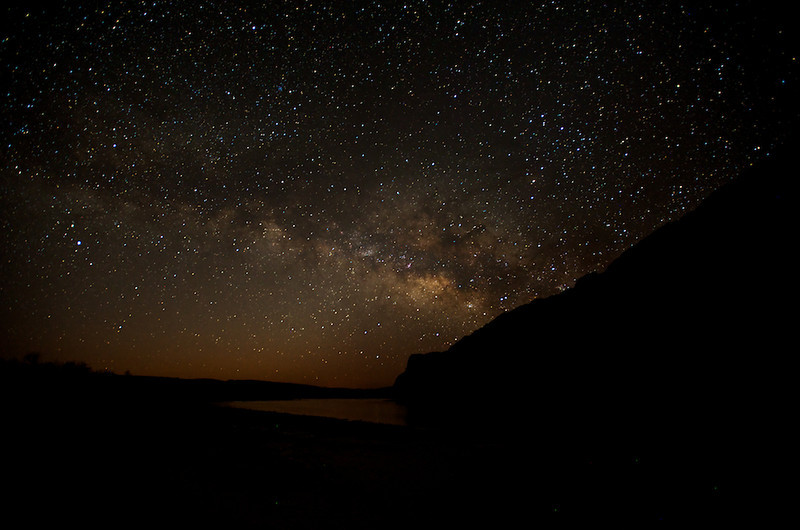 """BEHIND THE IMAGE:  RIO GRANDE MILKY WAY  Rio Grande & Milky Way - Big Bend National Park, Texas, File# 1003643  <a href=""""http://www.tom-hill.biz/Galleries/Scenics/Texas/20957785_4bMVTP#!i=1666093565&k=qZSV6P3&lb=1&s=A"""">  Link To Original Image </a>  Part of the buildup to my epic ride east around Memorial Day, 2010 I took a few shorter trips to increase my experience riding long distances on a bike.  The first major trip I took only a few weeks after acquiring the bike was a trip to Big Bend National Park.  I wrote a whole trip report on this ride that's located here.  As I noted in the article, the entire area around Big Bend, NP, is one of the darkest in the whole continental United States.  If you looked a night sattelite image of the US, you would see a gigantic black hole in the south texas area.  A large region where city or town lights aren't polluting the night skies.  What do you get when you have such pristine night skies?  You get lots of stars.  If you're a photographer, that means you get to shoot lots of stars.  As you know, ever since I acquired my Nikon D3, my interest in low light photography has increased dramatically.  The camera is simply amazing in its ability to render night scenes at high ISO levels without terrible amounts of noise to deal with.  As you know, noise is pretty common when you shoot at high ISO levels.  And, you know the whole reason to shoot at high ISO levels is to be able to capture just the dark objects like night stars that otherwise wouldn't be captured.  Of course, there's more to capturing night skies than just increasing the ISO setting on your camera.  You could always shoot at longer exposures to collect enough light.  I do this as a technique when I'm trying to make star trails like these images  Cheers  Tom"""