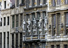 "Allegoric ethnic figures from various continents flank a statue of Blind Justice, on the facade of ""De Vos"" (The Fox), Guild House of the Haberdasher (yarn merchants) - a portion of four different guild hall facades - Grand Place (Market Square) - Brussels"