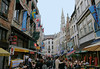 Rue des Butchers (butchers' street) - lined with many ethinic cuisines - with the the top of the Stadhuis (Town Hall) spire in the background - Brussels