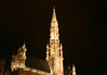 Nocturnal view of the tower and spire, with the Archangel, St. Michael slaying the devil (evil) atop the - Stadhuis (Town Hall) - Brussels