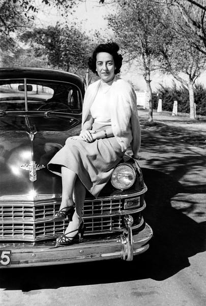 Lisette atop the Chrysler