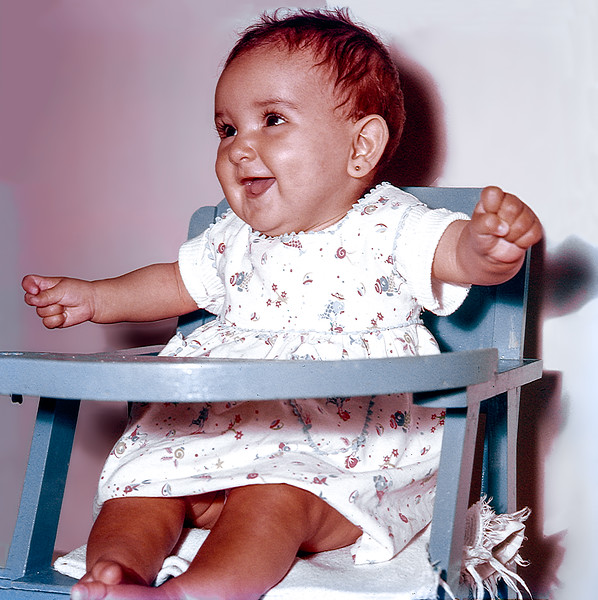 Lisita in her high chair - August 1958
