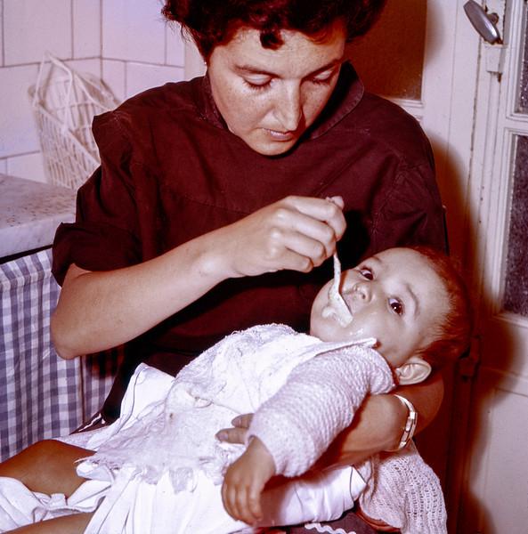 Alegria feeding Lisita - June 1958