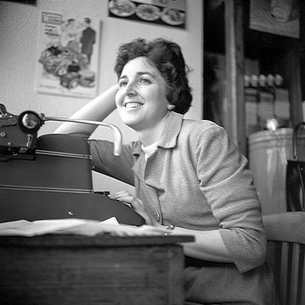 Alegria at her typewriter