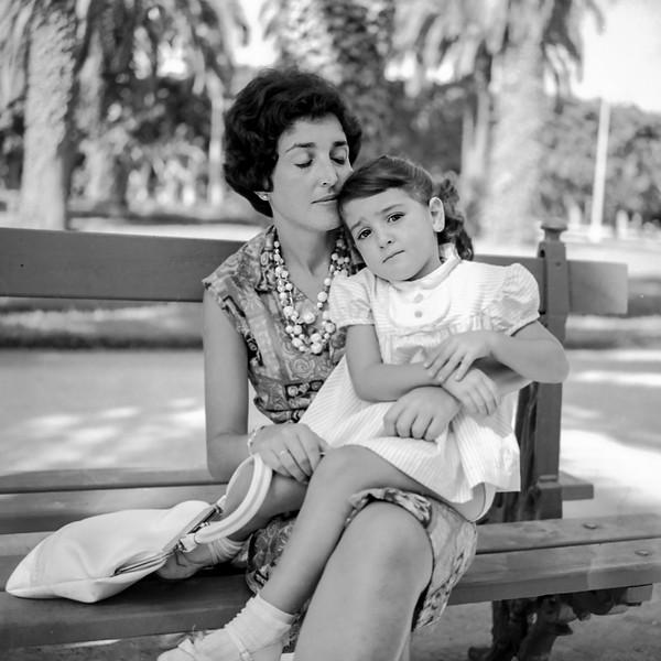 Alegria holding Lisita on park bench
