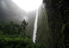 1,200 ft. (366 m) up the lower cascade of Hi'ilawe Falls - the tallest waterfalls on the island - with the Hakalaoa Falls on the left, among the misty clouds atop the Waipi'o Valley wall - Kohala district