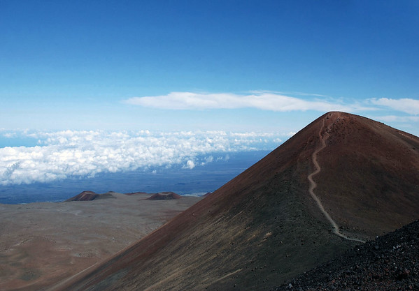 Mauna Kea Volcano summit - rising to 13,796 ft. (4,205 m) - the highest point in the state of Hawaii - Hamakua district - ALSO - the tallest mountain on Earth (from base to peak), measured at about 33,500 ft (10,210 m) from the Pacific floor.