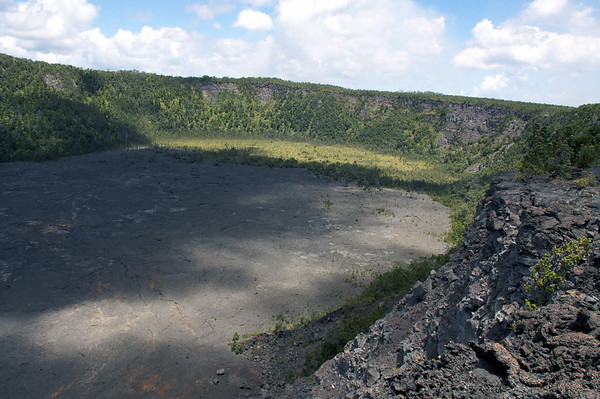 Cloud shadow on the floor of Makaopuhi Crater - the largest pit crater on Kilauea Volcano, measuring about 2,100 ft. (640 m) long, 1,300 ft. (400 m) wide and 300 ft. (90 m) deep - located on the Upper East Rift - Hawaii Volcanoes National Park