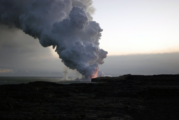 Lava glow upon the base of the Pu'u O'o steam cloud at sunset - Hawaii Volcanoes National Park