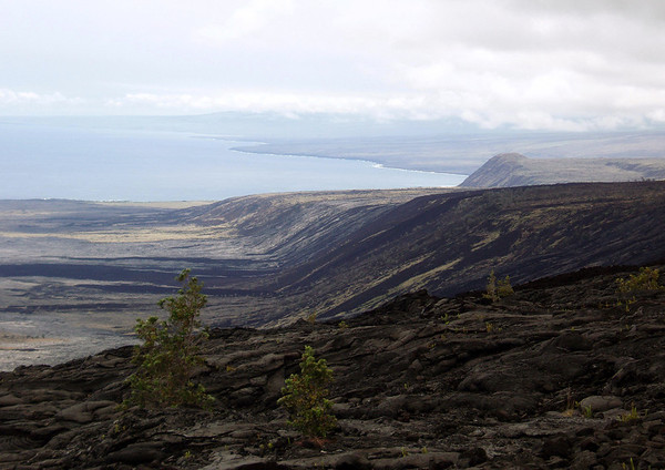 Lava flows from Mauna Ulu (1969-1974) - over the 400 ft. (122 m) tall Holei Pali (cliffs) - down to the Puna Coast - Hawaii Volcanoes National Park