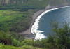 "About 1,500 ft. (457 m) down to the Waipi'o Stream, flowing into the Pacific Ocean, along the black sand of Waipi'o Beach (meaning ""curved water"") - Kohala district"