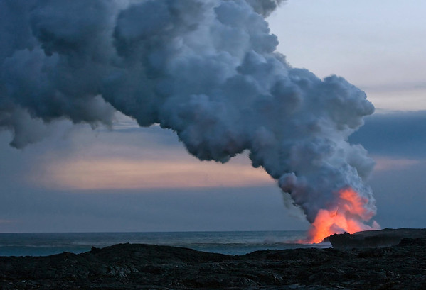 Dual orange radiance glow - the Kilauea Volcano lava with the Pacific sunset - Hawaii Volcanoes National Park