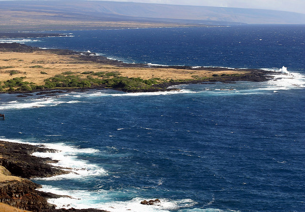 Pacific Ocean waves breaking on the point at Honu'apo (Turtle Bay) - to the distal Holei Pali (cliffs), the southern slopes of the Kilauea Volcano - Kaʻū district