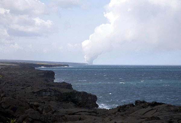 From the cloud shaded lava cliffs, to the steam cloud created from the molten lava flowing from Pu'u 'O'o, into the Pacific Ocean - Hawaii Volcanoes National Park