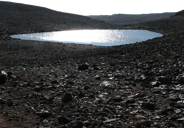 Lake Waiau - lies in the crater of Pu'u Waiau cinder cone on Mauna Kea Volcano at an elevation of 13,025 ft. (3,970 m) above sea level - it has a small average surface area of about 1.5 acre (0.6 ha) and a depth up to about 7.5 ft. (2.3 m) - Hamakua district