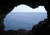 From a lava cave in Hawaii Volcanoes National Park - viewing southward across the Pacific Ocean - where about 22 mi. (35 km) off the coast from here is the Lo'ihi Seamount - an active undersea volcano that rises about 9,843 ft. (3,000 m) above the ocean's floor, and is about 3,000 ft. (915 m) below sea level