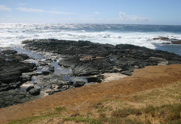 Ka Lae (Hawaiian meaning -The  Point) - which is geographically the southern most point of the 50 U.S. states - at the southern end of the Mauna Loa Volcano - Kaʻū district - viewing southwestward across the Pacific, in the direction of the American Samoa and Fuji Islands
