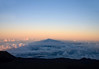 Mauna Kea Volcano's sunset shadow, across the tops of the clouds - the longest and largest shadow, I have ever experienced