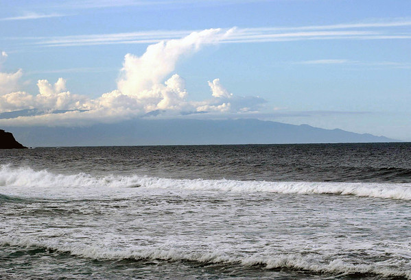 From the waves breaking onto Waipi'o Beach, in the Hamakua district - across the Alenuihaha Channel, about 30 mi. (48 km) wide and 6,000 ft. (1,829 m) deep - to the island of Maui (southeastern slope of the Haleakala Volcano) up in the clouds, rising to 10,023 ft. (3,055 m) above Pacific level