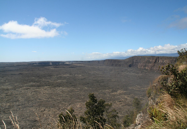 """Across the Kilauea Caldera to the Halema'uma'u Crater - Kilauea Volcano is the youngest and southeastern most of the 5 volcanoes on Hawaii - Kilauea means """"spewing"""" - Hawaii Volcanoes National Park"""