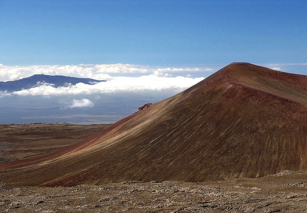 Mauna Kea Volcano cinder cone (cinders are melted volcanic rock that cooled and formed pebble-sized pieces when it was thrown out into the air from the cone's single vent, and accumulate around the vent when they fall back upon the ground) - to the Mauna Loa Volcano summit - the two tallest mountains in the Pacific Ocean