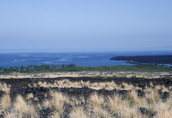 From the northern flank of Hualalai Volcano (Hana district) - northward view across Kiholo Bay - to the slightly visible western flank of the Kohala Volcano and Peninsula (R horizon)