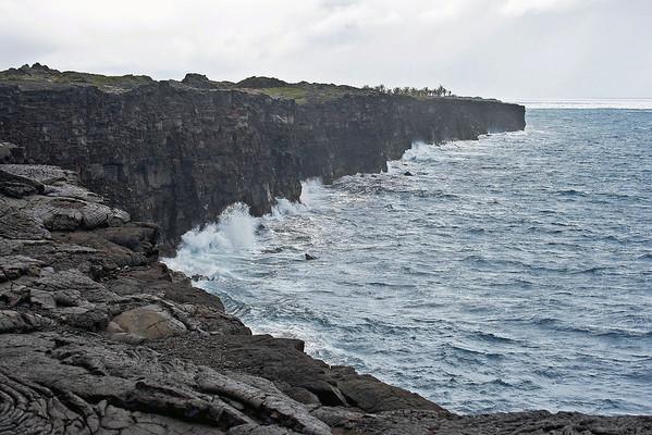 Pacific waves breaking into the lava cliffs - Hawaii Volcanoes National Park