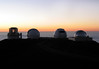 Sunset over the Subaru, Keck and NASA Observatories - atop the Mauna Kea Volcano, and above the distal solid cloud blanket - Hamakua district