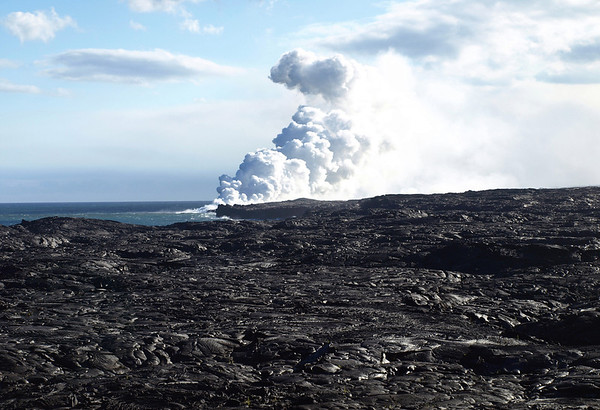 Across the sheen of the pahoehoe lava - to the fusion of a lava steam cloud with the atmospheric clouds - Hawaii Volcanoes National Park