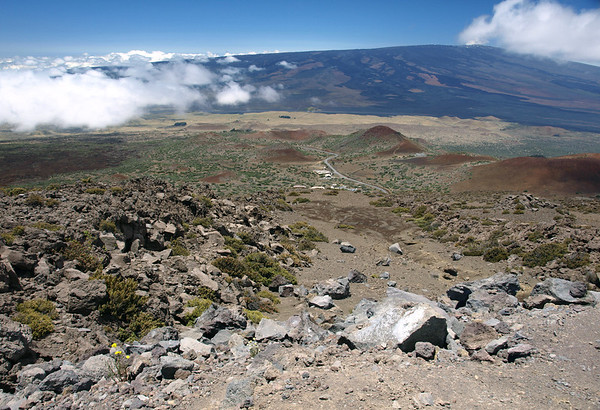 From the southern flank of Mauna Kea, at about 10,000 ft. (3,048 m) elevation, in the Hamaku region - across to the ridge of Mauna Loa, that peaks at 13,681 ft. (4,170 m), in the Kau region - with the Onizuka Center for International Astronomy below