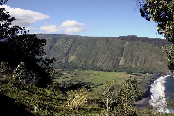 Waipi'o Valley - the largest, measuring about 1 mi. (1.6 km) wide at the beach, 2,000 ft. (610 m) tall cliff walls, and around 5 mi. (8 km) deep, and most southern of the 7 valleys on the windward (eastern) side of the Kohala Volcano (the inactive and oldest of the 5 volcanoes that forms the Big Island Hawaii) - Kohala district