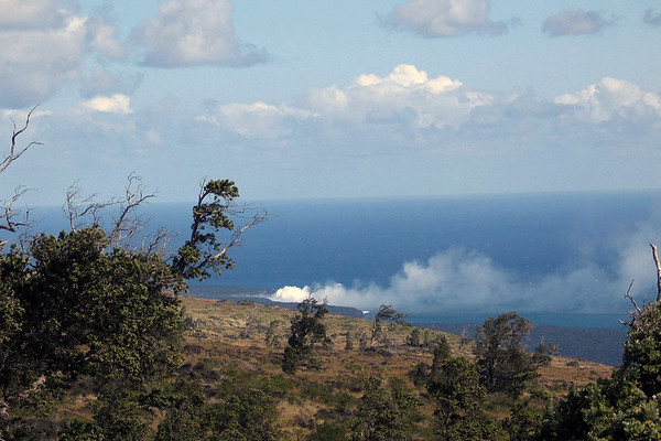 Lava from Pu'u 'O'o flowing into the Pacific Ocean creating a steam cloud - Hawaii Volcanoes National Park
