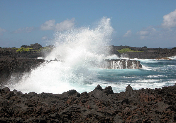 Pacific waves breaking upon the igneous lava shoreline at Cape Kumukahi - the easternmost point of the Hawaiian Islands - Puna district