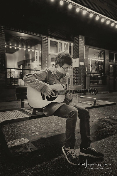 Playing a guitar on Granville