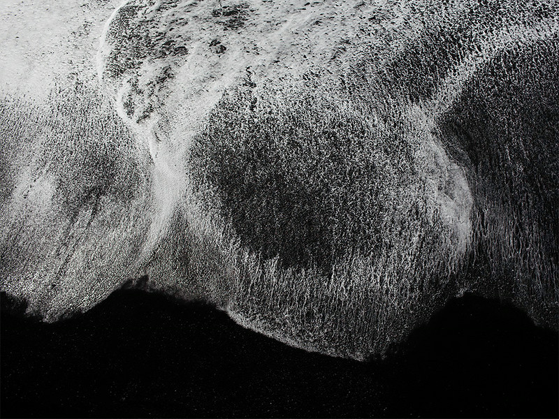 Ebb and flow of surf on black sand beach, Dyrolaey, Iceland