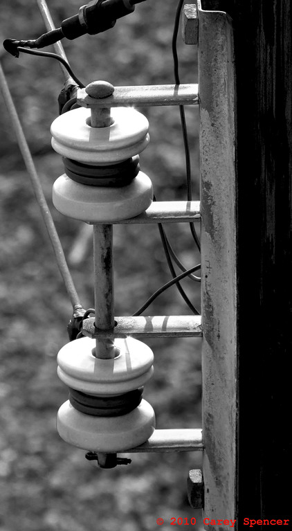 Black and White Photograph of old Porcelain Wire Insulators along train tracks downtown Birmingham, Alabama