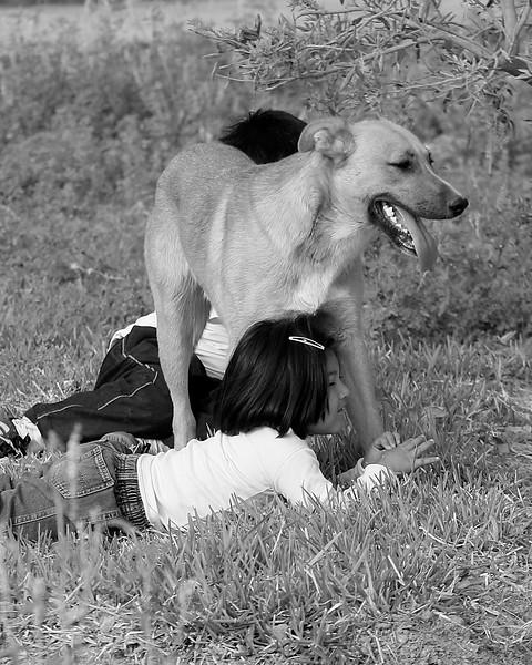 children and dog relaxing Peru