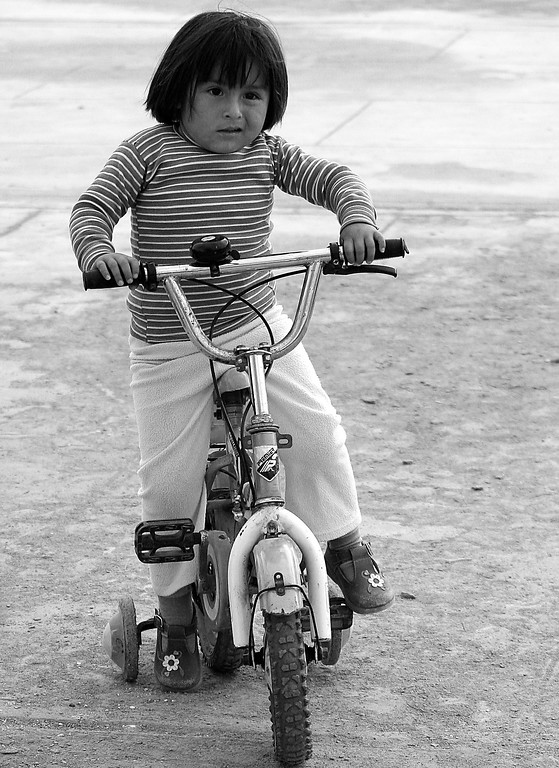 young girl riding bike Peru