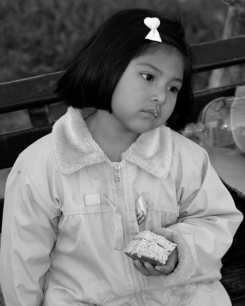 Girl eating cake Peru