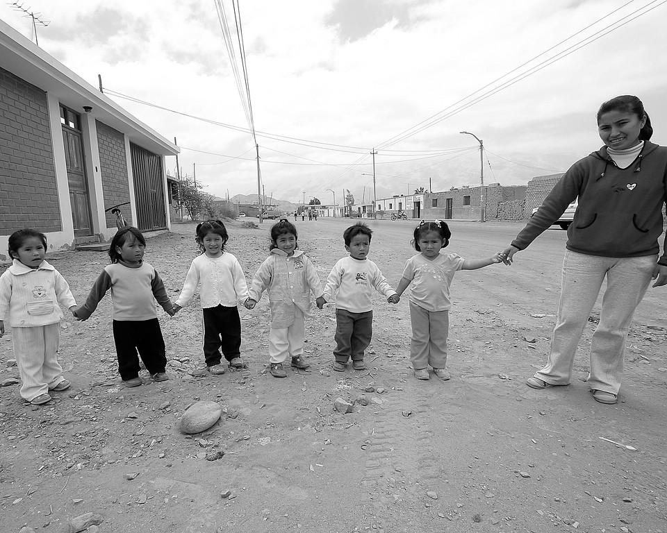Preschool children heading to school in Peru
