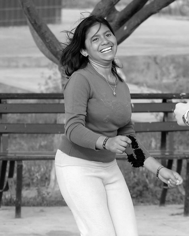 Girl jumping rope in park Peru