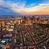Aerial View of Downtown Boston Skyline at Sunset from Helicopter over Beacon Hill with West End, Boston Common, East Boston, Logan Airport, Winthrop, Deer Island, and Boston Harbor Islands