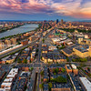 Aerial View of Boston Skyline and Sprawling Neighborhoods at Sunset
