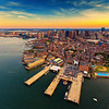 Aerial View of North End Waterfront and Downtown Boston Skyline at Sunset with South Boston, Boston Harbor Islands, and Back Bay