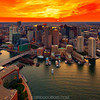 Dipping Sun and Fiery Sunset over Downtown Boston Skyline and Waterfront from the Sky