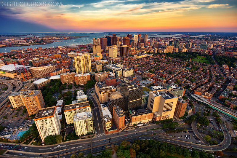 Aerial View of Boston Skyline at Sunset from Helicopter with West End Foreground and Boston Harbor Islands Background